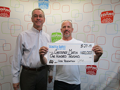 Christopher Martin with Idaho Lottery Director Jeff Anderson